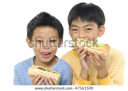 Couple boy eating sandwich smiling