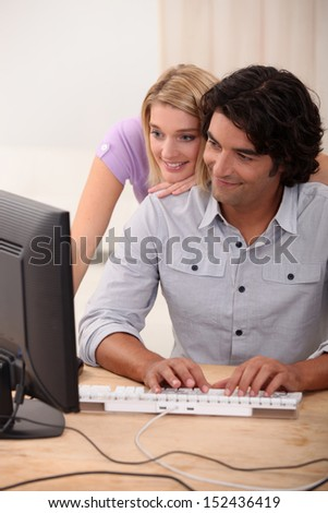 Couple browsing the Internet together - stock photo