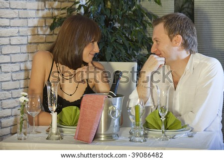 couple by romantic dinner in a restaurant - stock photo