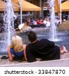 Couple by the fountain - stock photo