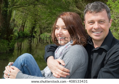 Couple by the river, a romantic day for lovers