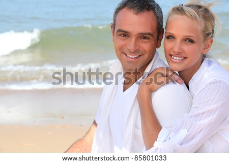 Couple by the sea - stock photo