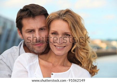 Couple by the water - stock photo