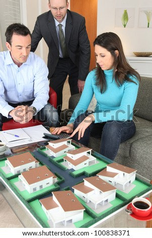 Couple calculating the cost of their new home - stock photo