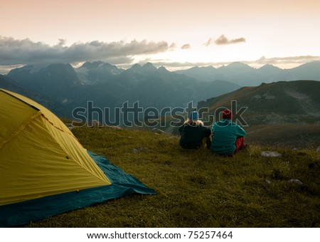 couple camping in wilderness - stock photo