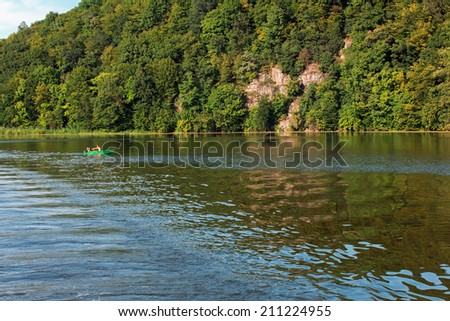 Couple canoes and relaxing around the beautiful island of mountains and green trees - stock photo