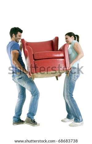 Couple carrying a chair - stock photo