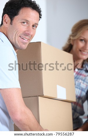 Couple carrying boxes - stock photo