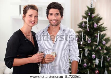 Couple celebrating Christmas - stock photo