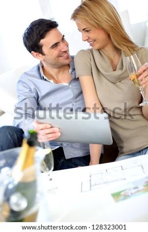 Couple celebrating construction of new home - stock photo