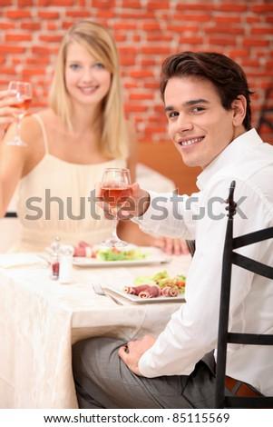 Couple celebrating in restaurant - stock photo