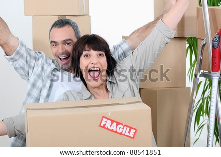 Couple celebrating moving in - stock photo