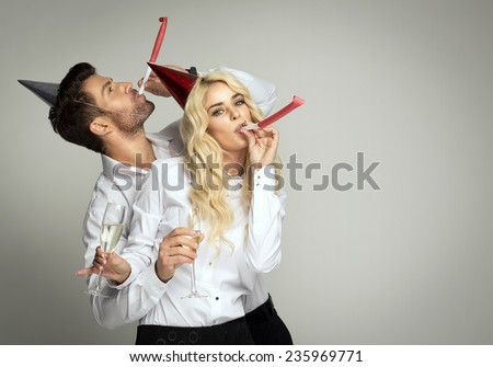 Couple celebrating new year's eve - stock photo