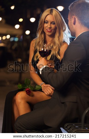 Couple celebrating proposal in the city at night