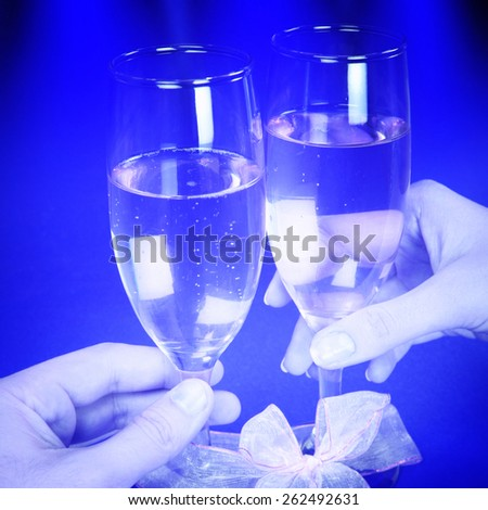 Couple celebrating valentine's day with champagne. - stock photo
