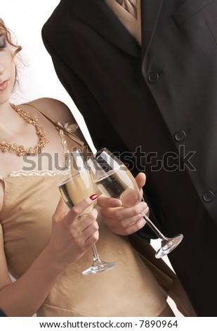 couple celebrating with champagne, toasting at a party - stock photo