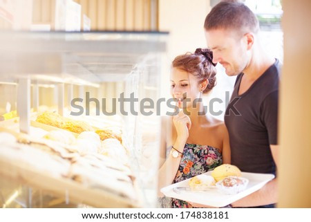 couple choosing food in a shop - stock photo