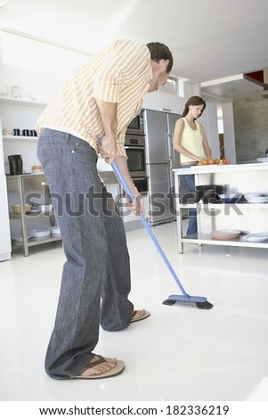 Couple cleaning the house - stock photo