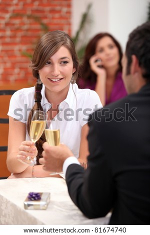 Couple clinking glasses - stock photo