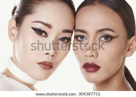 Couple close up portrait make-up asian models in concept fashion shooting in studio - stock photo