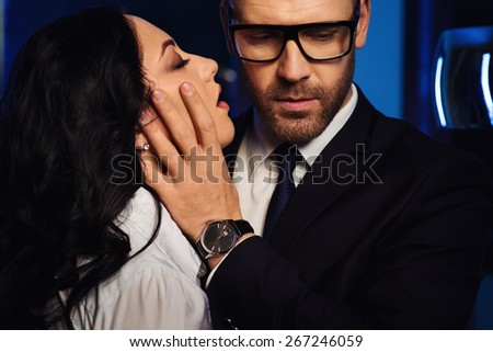 Couple close-up. Portrait of a sensual brunette and handsome businessman. Office romance concept  - stock photo