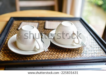 Couple coffee cups set on tray. - stock photo