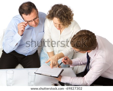 Couple consider signing an agreement. - stock photo