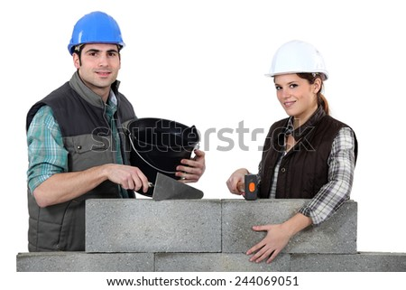 Couple constructing wall - stock photo