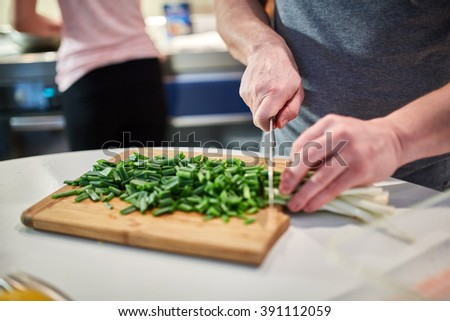 Couple cooking at home in a modern kitchen - stock photo