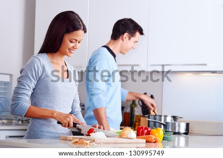 couple cooking healthy food in kitchen lifestyle meal preparation - stock photo