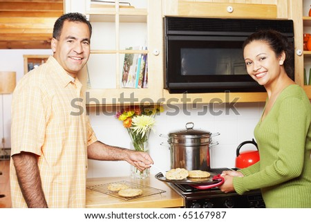 Couple cooking together - stock photo