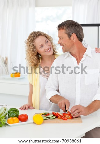 Couple cooking together in their kitchen at home - stock photo
