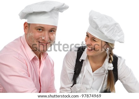 Couple cooking  together isolated on white.