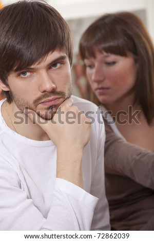 couple crisis - sad man and frustrated woman after conflict - stock photo