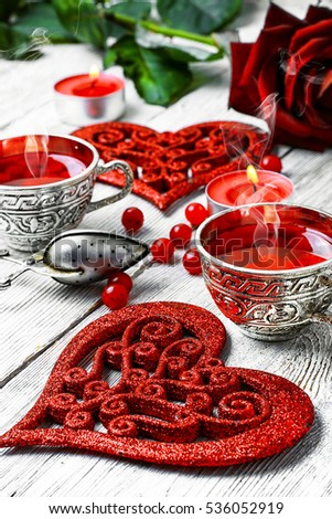 couple cups of tea and symbolic heart for Valentine's day