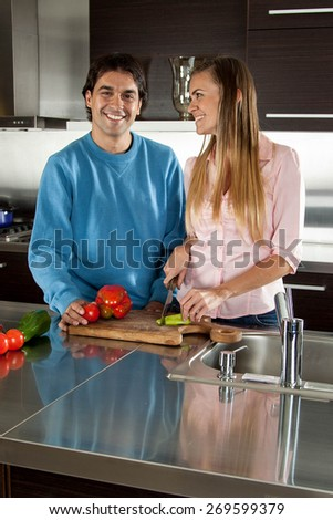 couple cutting vegetables