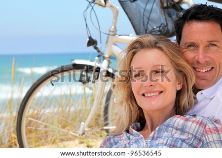 Couple cycle to the sea - stock photo