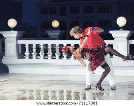 Couple dancing at the night time