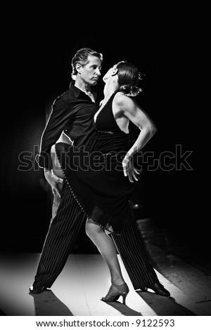 Couple dancing hot latin dance at night - stock photo