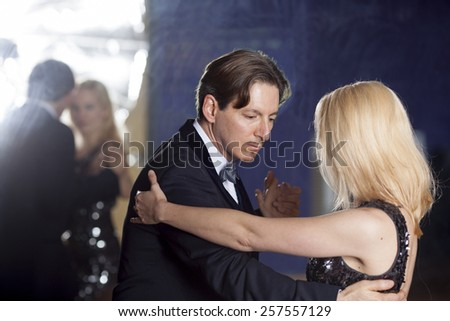couple dancing in formal wear with reflection in mirror - stock photo