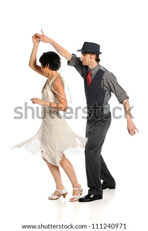 Couple dancing isolated over white background - stock photo