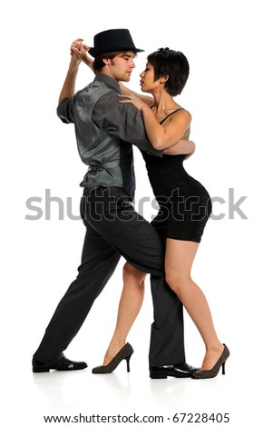 Couple dancing tango isolated over white background - stock photo