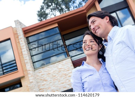 Couple daydreaming of buying a beautiful house - stock photo
