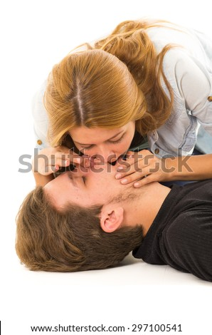 Couple demonstrating first aid techniques with woman performing mouth resuscitation. - stock photo