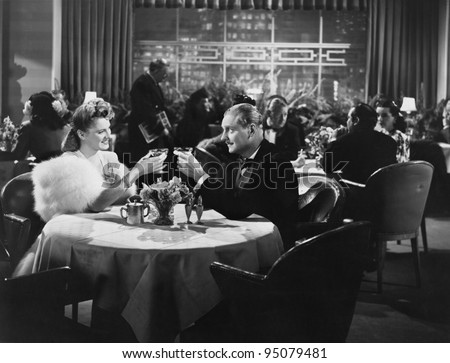 Couple dining in crowded restaurant
