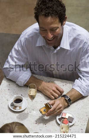 Couple dining in restaurant, man proposing to woman, elevated view - stock photo