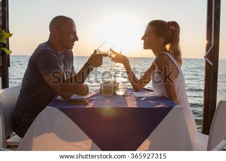 Couple dining in sea restaurant - stock photo
