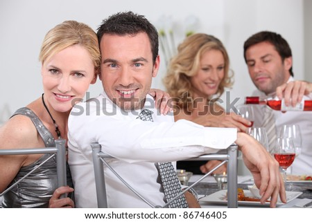 Couple dining with friends - stock photo