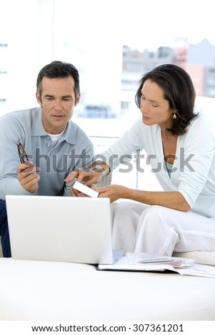 Couple doing home finances together - stock photo