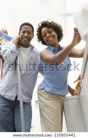 Couple Doing Household Chores - stock photo